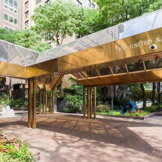 The Building's Entry at 100 United Nations Plaza in NYC - Apartments for sale