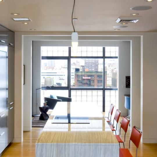 Dining room and kitchen - Flank - 520 West 27th Street - Chelsea Condos
